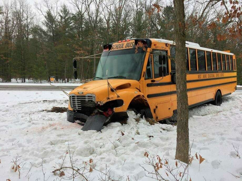 A West Shore Educational Service District bus was involved in a traffic crash Friday. A tractor trailer traveling east on U.S. 10 at Peacock Trail lost control and hit the front of the bus pushing it off the road. No injuries were reported. (Courtesyphoto)