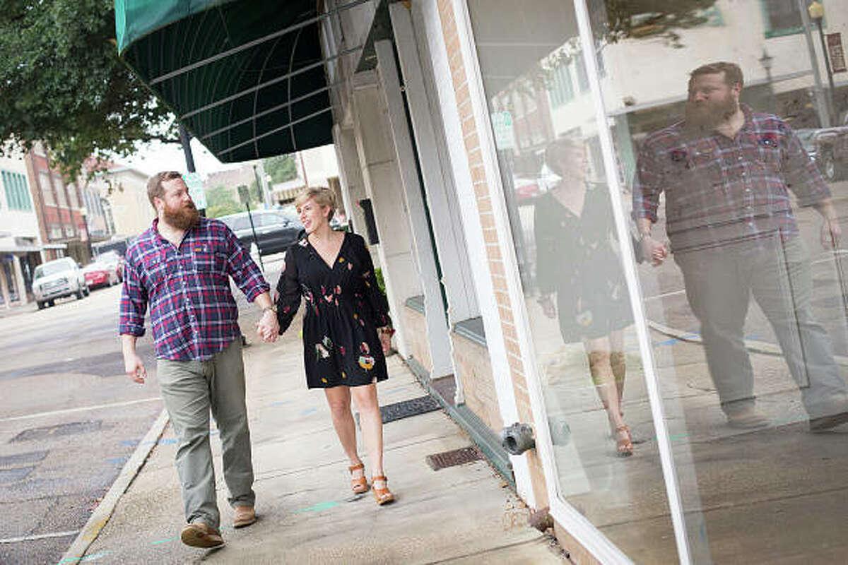 "Erin and Ben Napier, stars of HGTV's ""Home Town Takeover,"" walk through Laurel, Mississippi."
