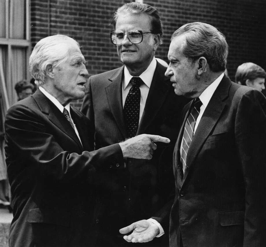 Former Michigan Gov. George Romney, from left, the Rev. Billy Graham and former President Richard Nixon outside the diocese of the Mormon Temple in Washington, D.C., on Aug. 17, 1885. Photo: Washington Post Photo By Dayna Smith / The Washington Post