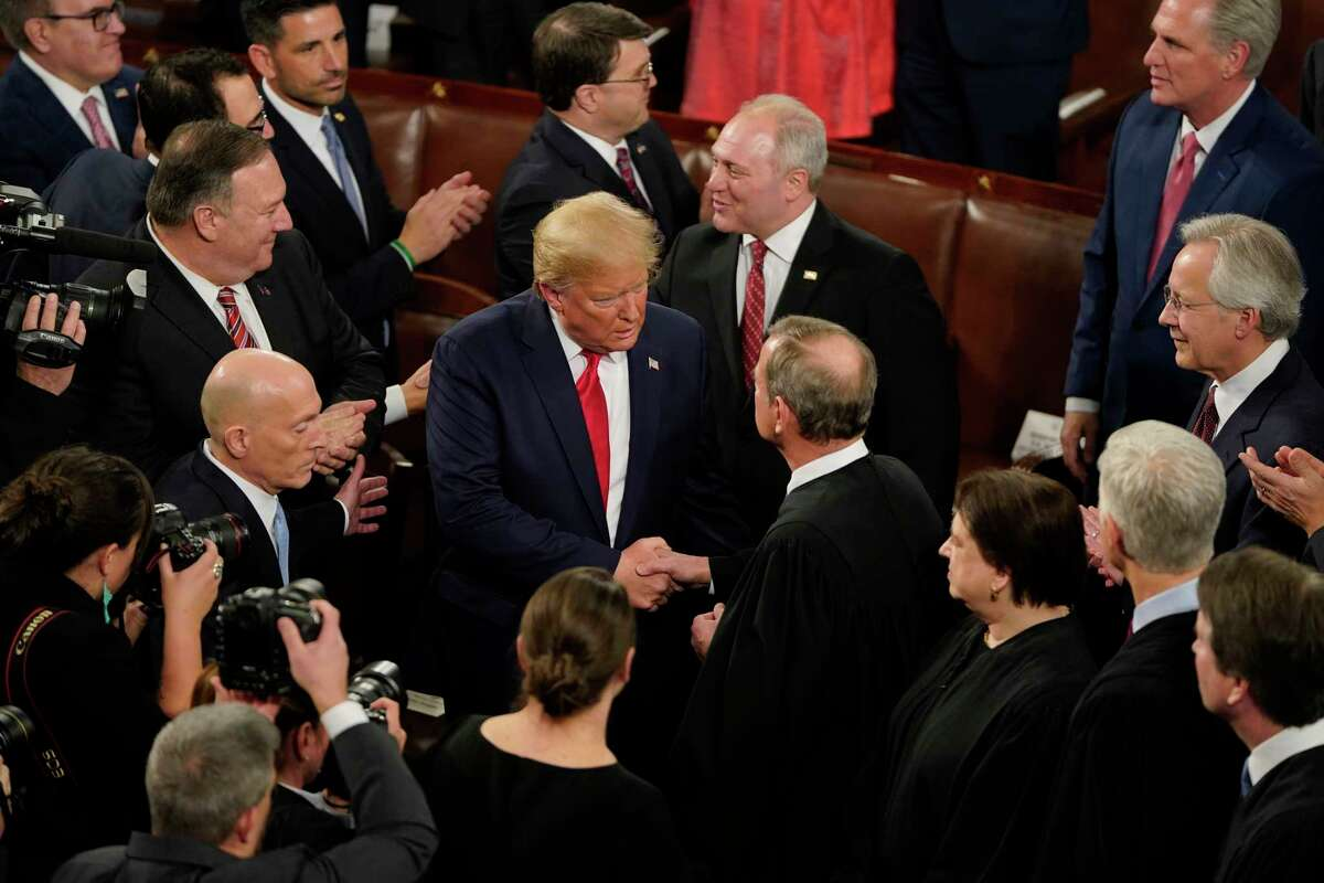 President Donald Trump greets Chief Justice John Roberts Jr. before the State of the Union address in the House chamber of the U.S. Capitol on Feb.y 4, 2020 in Washington, D.C.