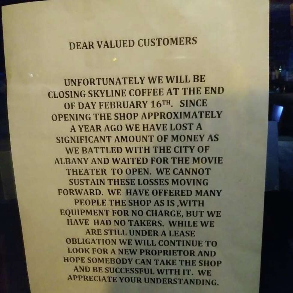 Sign on the door of Skyline Coffee in Albany.