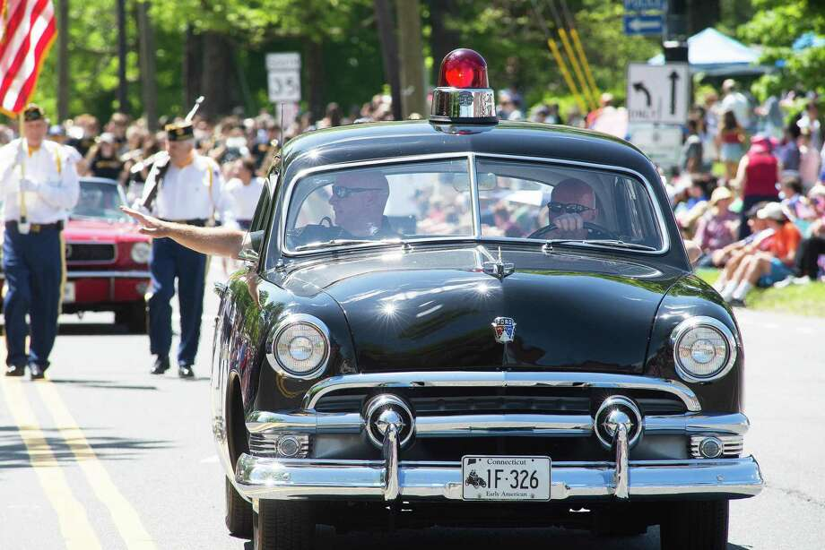 Ridgefield police chief Jeffery Kreitz waves to parade-goers from a vintage police car. Two thousand marchers representing more than 75 organizations marched Memorial Day, Monday, May 28, 2019. The parade started at Jesse Lee Church and ended in Ballard Park in Ridgefield, Conn. Photo: Bryan Haeffele / Hearst Connecticut Media / Ridgefield Press