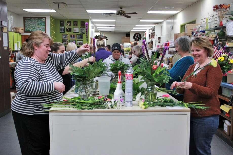 Patterson's Flowers smelled especially sweet as area residents gathered to enjoy a little springtime Wednesday night. In celebration of Festival of the Arts, guests were able to create their own floral arrangement. Here, they learned how to mix colors, types of flowers and how to keep the colorful arrangement fresh to brighten their homes during cold winter nights. Photo: (Pioneer Photo/Alicia Jaimes)
