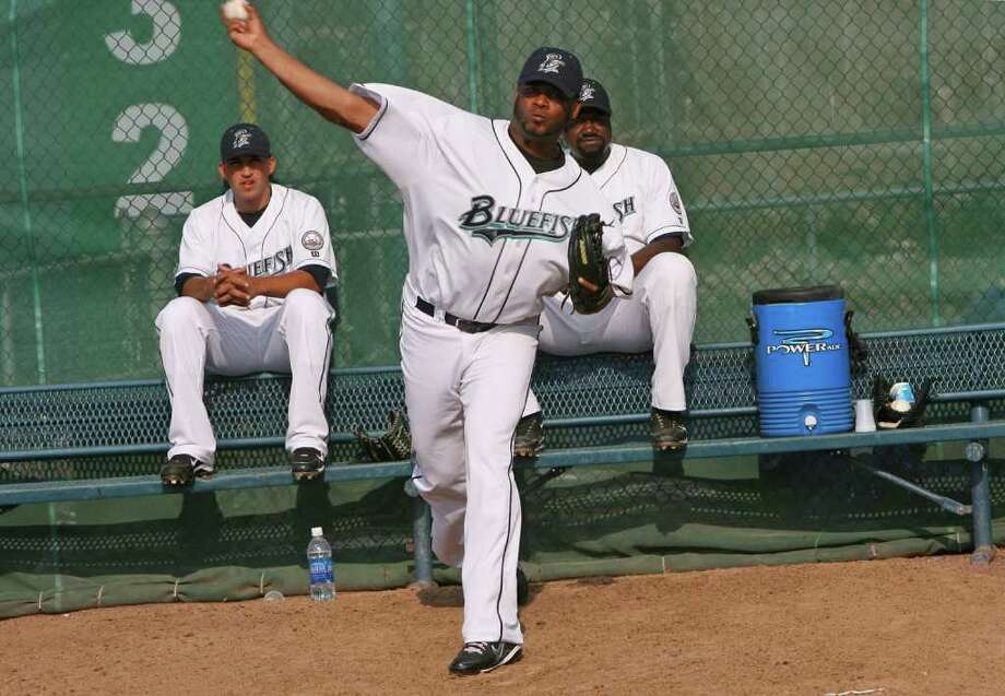 Bluefish pitcher Jorge Julio warms up in the bullpen during a game against the Camden Riversharks on Sunday, August 8, 2010. Also in the bullpen are Chris Rivera, left,  and Antonio Alfonseca. Photo: B.K. Angeletti / Connecticut Post
