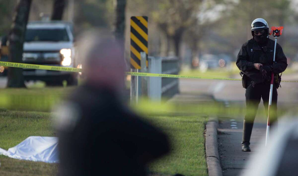 Harris County Sheriff's Office investigators work at a fatal auto-pedestrian call at the 3600 block of Addicks Clodine Road Thursday, Feb. 6, 2020, in Houston. It appeared a male between 50-60 years of age was struck by a vehicle and was pronounced deceased at the scene, Sheriff Ed Gonzalez tweeted.