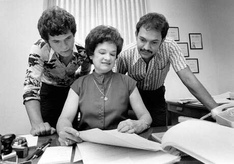 06/19/1979 - Alberto Pena, 19, left, and Fernando De Leon, 25 - the first two males to work as assistant city of Houston secretaries since 1938 - flank their boss, city secretary Anna Russell. They started work this week. Russell said they were the first male applicants for the jobs in her office for as long as she's been there.