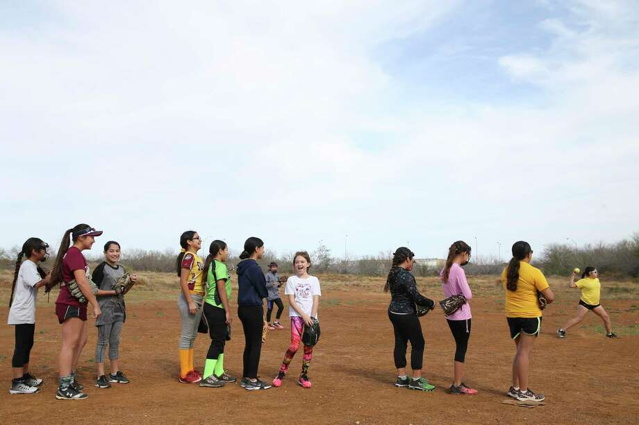 The Lil Storm 12U softball team practices in a field that used to house an oil-field service company on Guadalupe Street in Cotulla. Photo: Jerry Lara / **MANDATORY CREDIT FOR PHOTOG AND SAN ANTONIO EXPRESS-NEWS/NO SALES/MAGS OUT/TV   © 2019 San Antonio Express-News