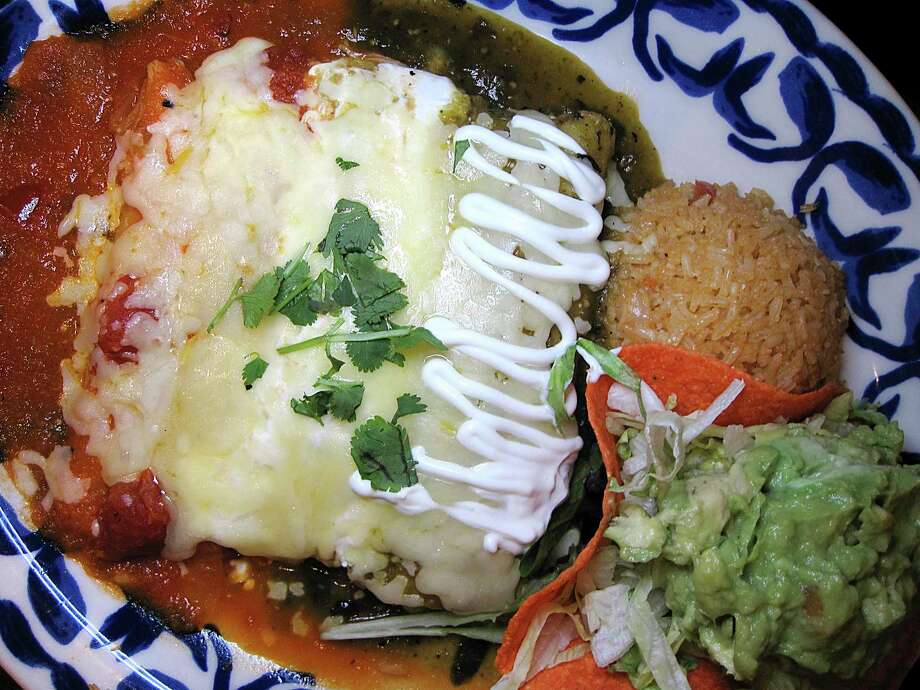 Enchiladas Tres Colores includes a chicken enchilada verde, a sour cream enchilada with chicken and an enchilada ranchera at Mi Familia de Mi Tierra. Photo: Mike Sutter /Staff