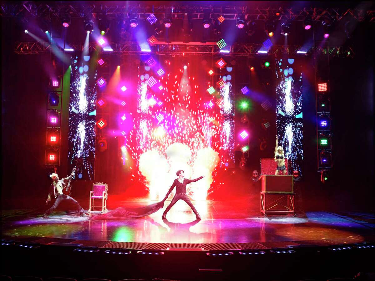 Video screens add to the pyrotechnics at a Criss Angel show.