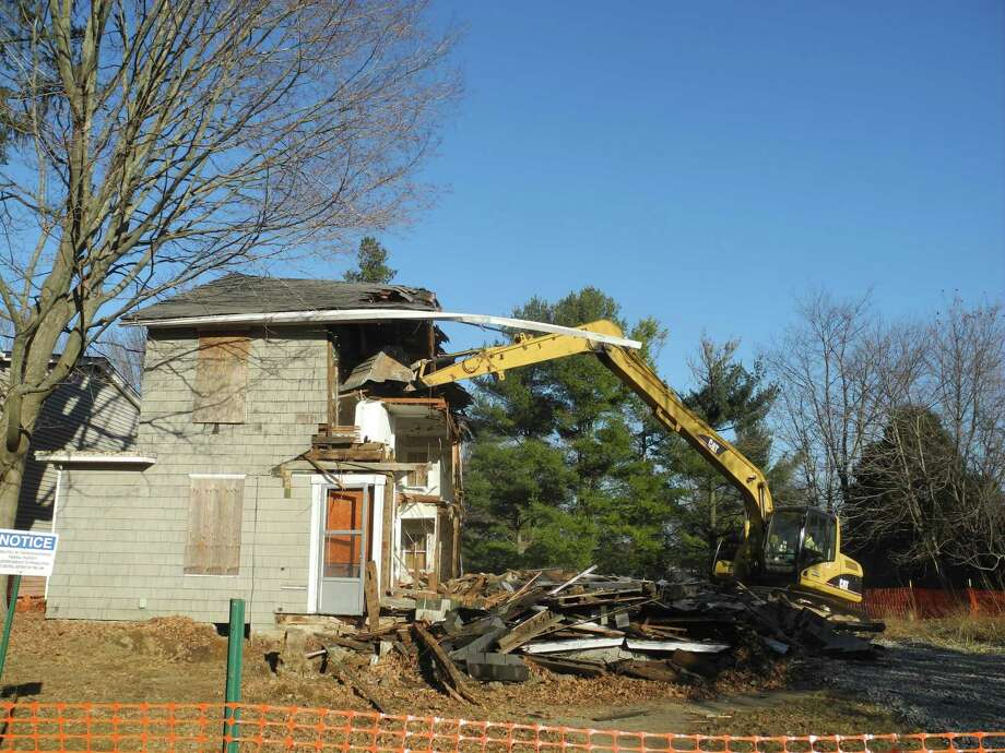 When this house was torn down on Catoonah Street in 2016, there was no demolition delay ordinance, but it was a case where public sentiment seemed to favor demolition rather than saving. Photo: Macklin Reid / Hearst Connecticut Media