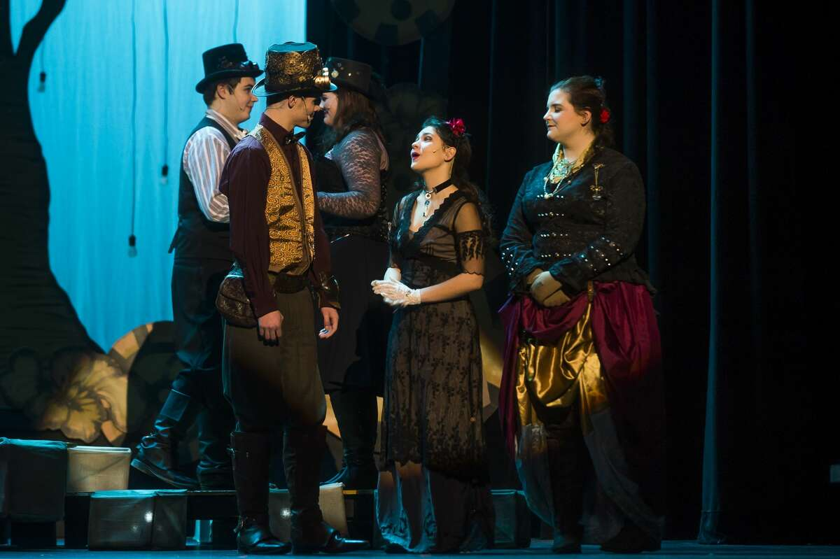 """From left, George Hageage in the role of Charles Babbage, Emma Massey in the role of Ada Byron Lovelace and Kennedy Danner in the role of Lady Anabella Byron act out a scene during a dress rehearsal for Midland High School's production of """"Ada and the Engine"""" Wednesday, Feb. 6, 2020 at Central Auditorium. (Katy Kildee/kkildee@mdn.net)"""