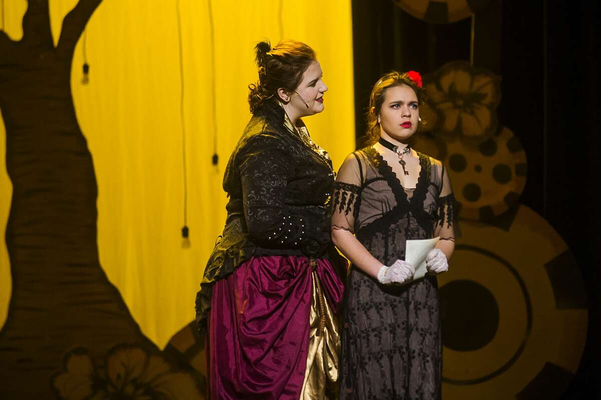 """Kennedy Danner in the role of Lady Anabella Byron, left, and Emma Massey in the role of Ada Byron Lovelace, right, act out a scene during a dress rehearsal for Midland High School's production of """"Ada and the Engine"""" Wednesday, Feb. 6, 2020 at Central Auditorium. (Katy Kildee/kkildee@mdn.net)"""