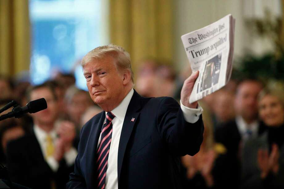 "President Donald Trump holds up a newspaper with the headline that reads ""Trump acquitted"" as he speaks in the East Room of the White House in Washington, Thursday, Feb. 6, 2020. Photo: Patrick Semansky, AP / Copyright 2020 The Associated Press. All rights reserved."