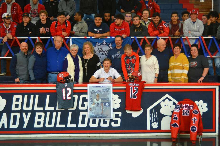 Plainview High School senior Peyton McNutt was joined by family, friends, teammates and coaches as he signed his National Letter of Intent to play college football for Southwestern Oklahoma State University on Wednesday, Feb. 5, 2020 in the Dog House. Photo: Nathan Giese/Planview Herald