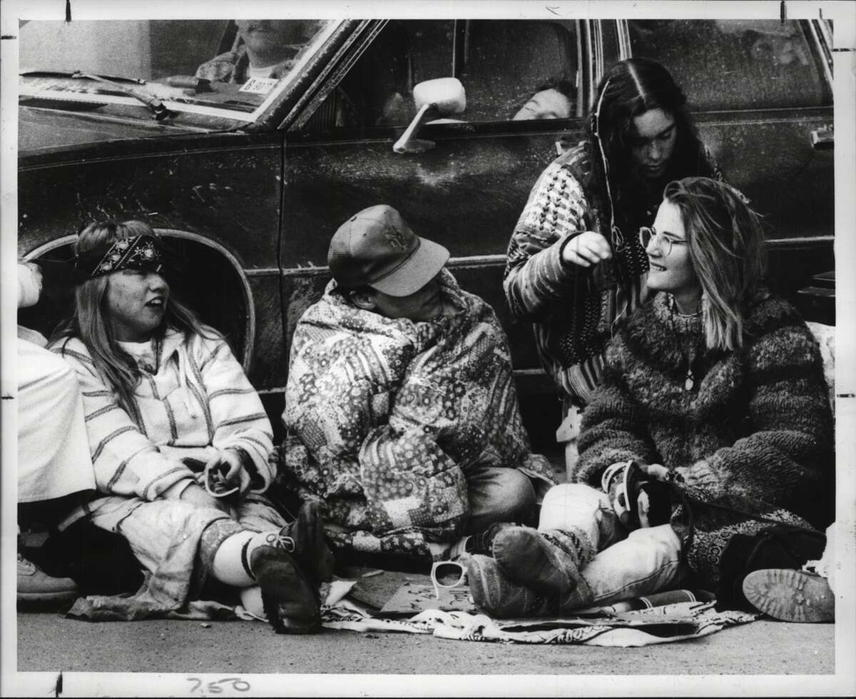 March 24, 1990: Grateful Dead fans braid and bead hair in the parking lot of the boat launch at Corning Preserve before the concert at the Knickerbocker Arena.