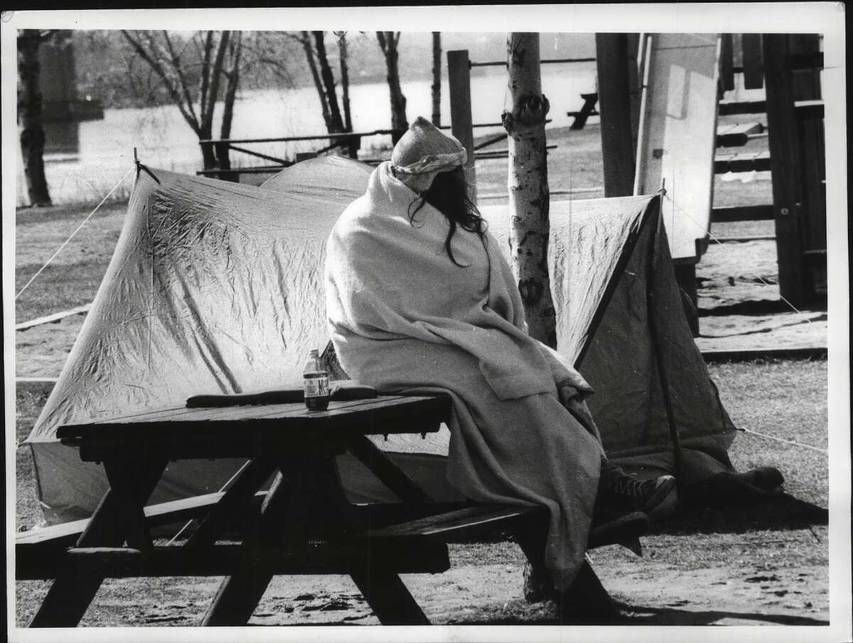 Grateful Dead fans at their camp at Corning Preserve on Feb. 27, 1990 wake up to the cool weather by the river, with some late sleepers still in their tents.