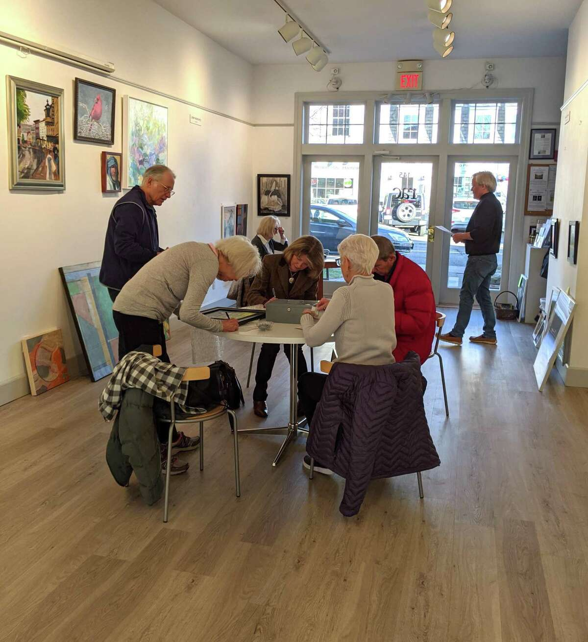 Artists in the RAC gallery dropping off and picking up.