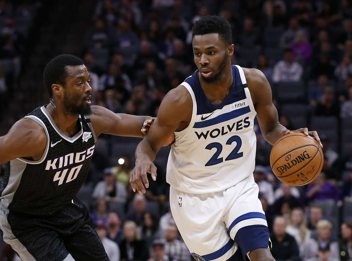 Minnesota Timberwolves guard Andrew Wiggins, right, drives against Sacramento Kings forward Harrison Barnes, left, during the first quarter of an NBA basketball game in Sacramento, Calif., Monday, Feb. 3, 2020. The Kings won 113-109. (AP Photo/Rich Pedroncelli)