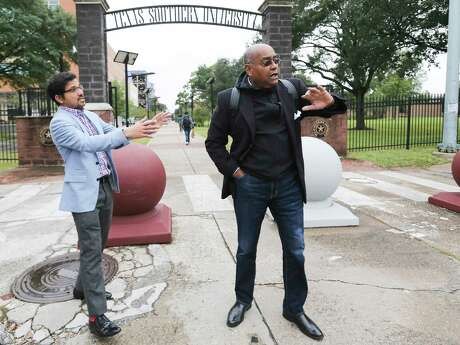 Amar Mohite, Harris County Precinct 1 Director of Planning and Infrastructure, left and Commissioner Rodney Ellis, talk about plans for a new entrance for Texas Southern University that is more pedestrian and cyclist friendly outside the Houston campus on Nov. 19, 2018.