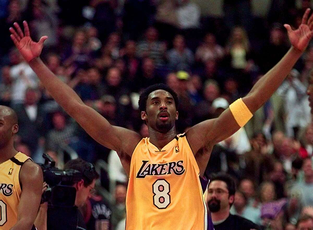 Los Angeles Lakers' Kobe Bryant gestures to the crowd at the end of the second period against the Denver Nuggets in Los Angeles Monday, Jan. 10, 2000. (AP Photo/Michael Caulfield) HOUCHRON CAPTION (02/06/2000): The bizarre saga of Leon Smith has cast new light on the alarming trend toward teen-agers entering the NBA. Sure, there have been some success stories, but for every Kobe Bryant, (pictured) below, and Kevin Garnett, there are countless others like Smith who have struggled or failed to make it altogether. HOUCHRON CAPTION (03/26/2000): After enduring his share of growing pains, Kobe Bryant has started to harness his immense individual talents and become more team-oriented.