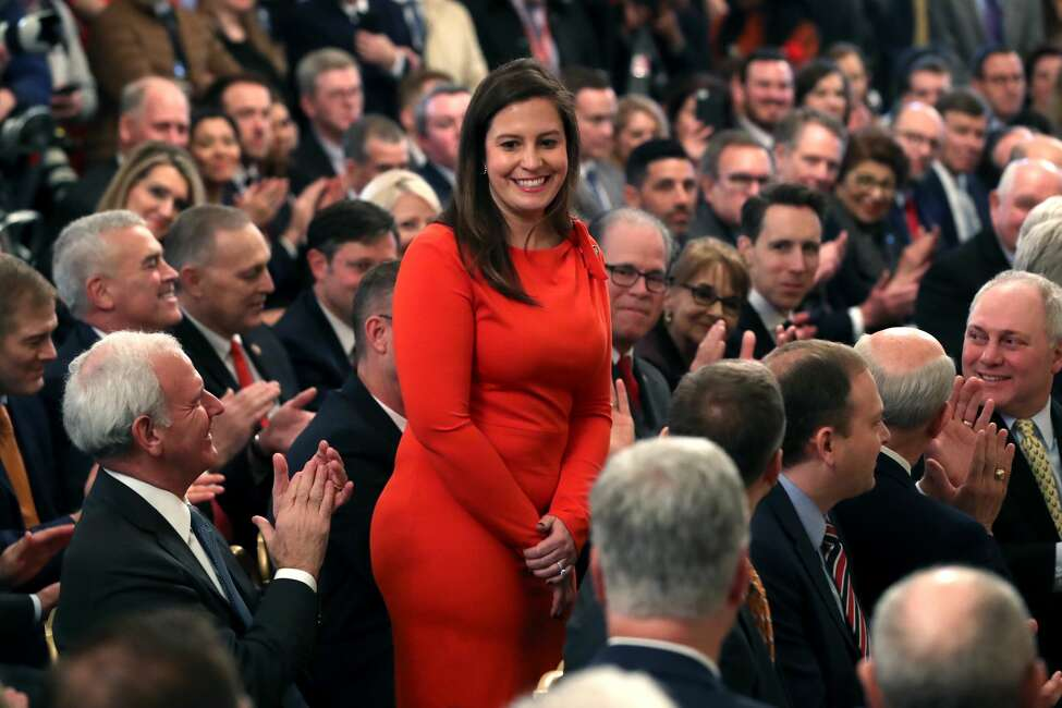 Elise Stefanik (R-NY) (C) stands as she's acknowledged by U.S. President Donald Trump as he speaks one day after the U.S. Senate acquitted on two articles of impeachment, in the East Room of the White House February 6, 2020 in Washington, DC. After five months of congressional hearings and investigations about President Trumps dealings with Ukraine, the U.S. Senate formally acquitted the president of charges that he abused his power and obstructed Congress. (Photo by Mark Wilson/Getty Images)