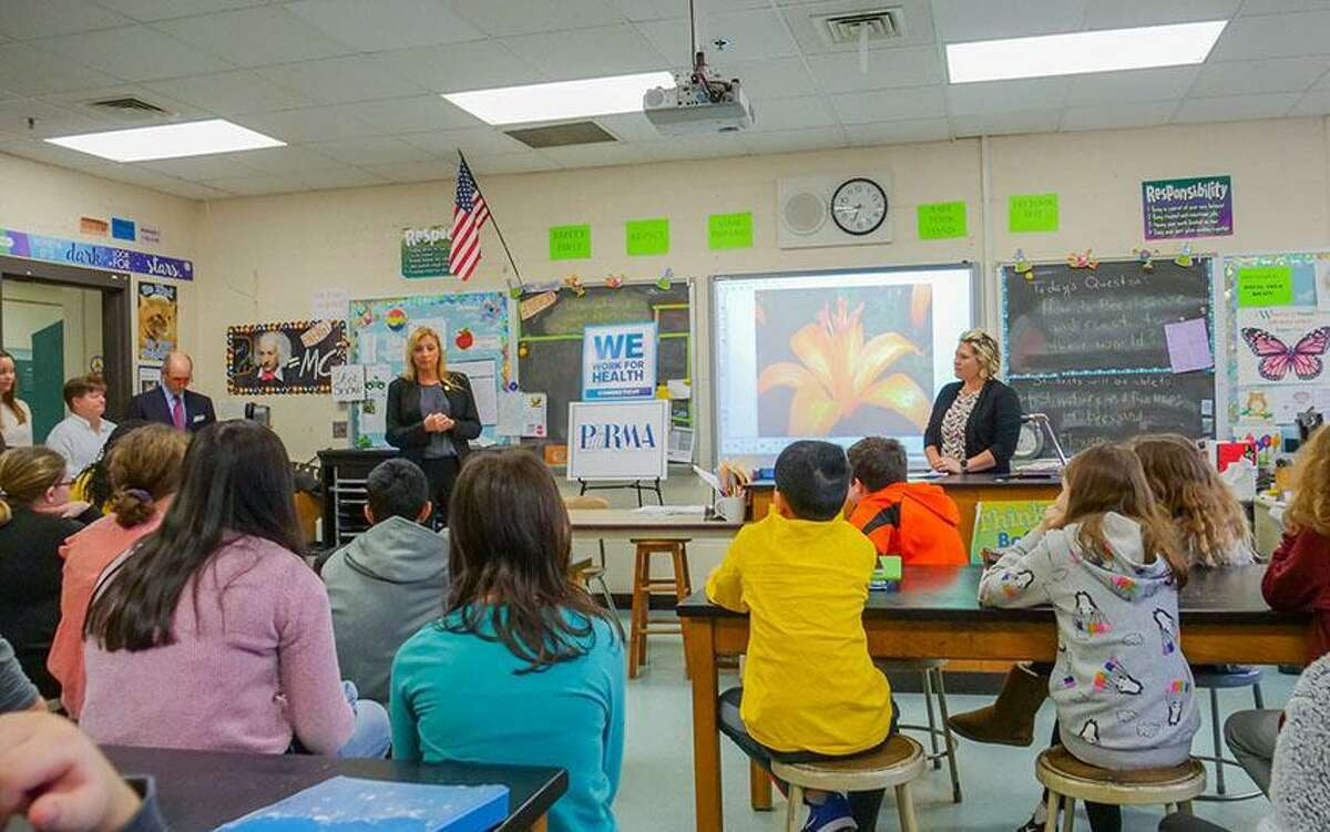 State Rep. Michelle Cook,D-Torrington,joined Jessica Frasco, director of advocacy and strategic alliances of the Pharmaceutical Research and Manufacturers of America (PhRMA), to announce PhRMA's new educational grant for Torrington Middle School to support the school's science, technology, engineering and math (STEM) programs.