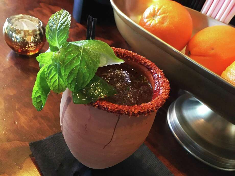 The Mexican Mule at Espuelas is one of the signature drinks on the cocktail menu. Photo: Chuck Blount /Staff