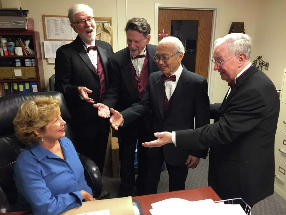A Coastal Chordsmen quartet serenades Donna Wong of Monroe in preparation for Valentine's Day, Feb. 14. Quartets will deliver singing Valentines in Fairfield and New Haven counties. Singing from left are Phil Kraft, Darien; Richard Allman, Shelton; Kellogg Wong, Monroe; and Jim Farrell, Bridgeport. Photo: Coastal Chordsmen / Contributed Photo