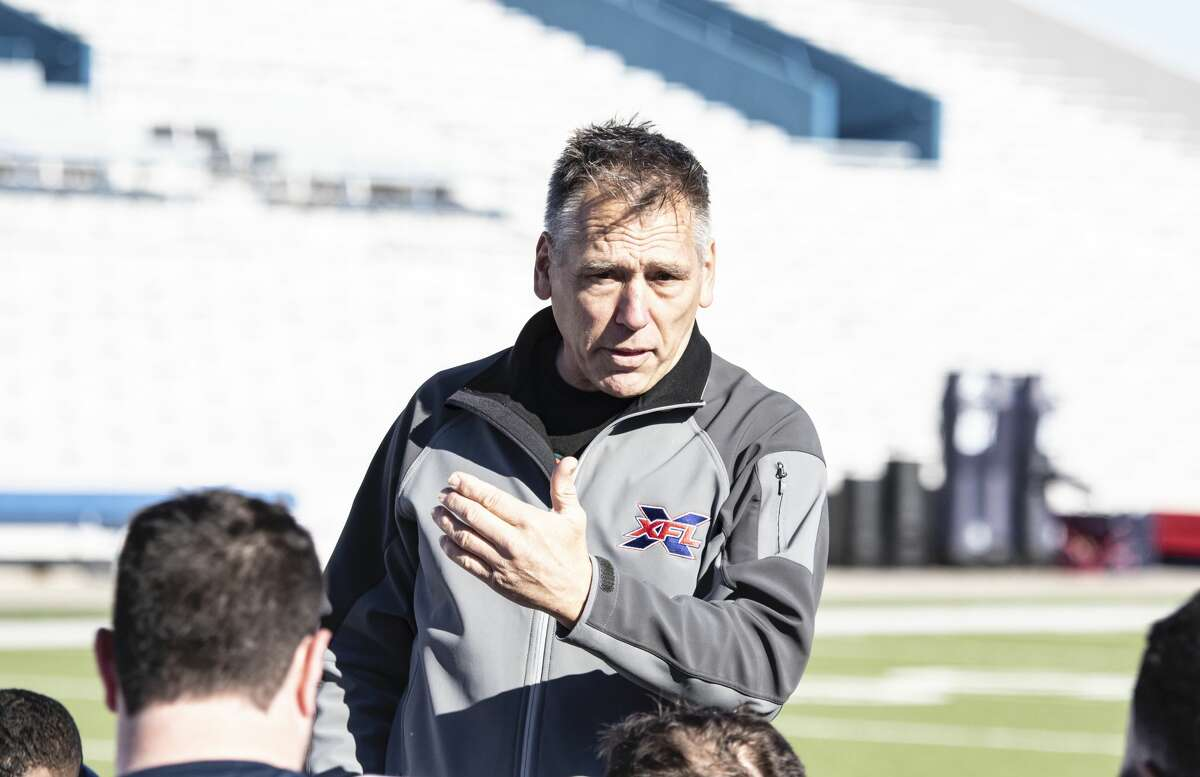 Seattle Dragons head coach Jim Zorn talking to the team during a practice.