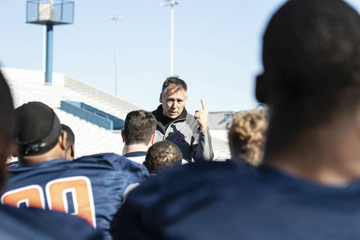 Seattle Dragons head coach Jim Zorn talking to the team during practice.