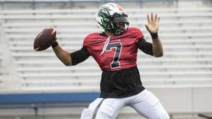 Seattle Dragons B. J .  Daniels  throwing a ball during practice.