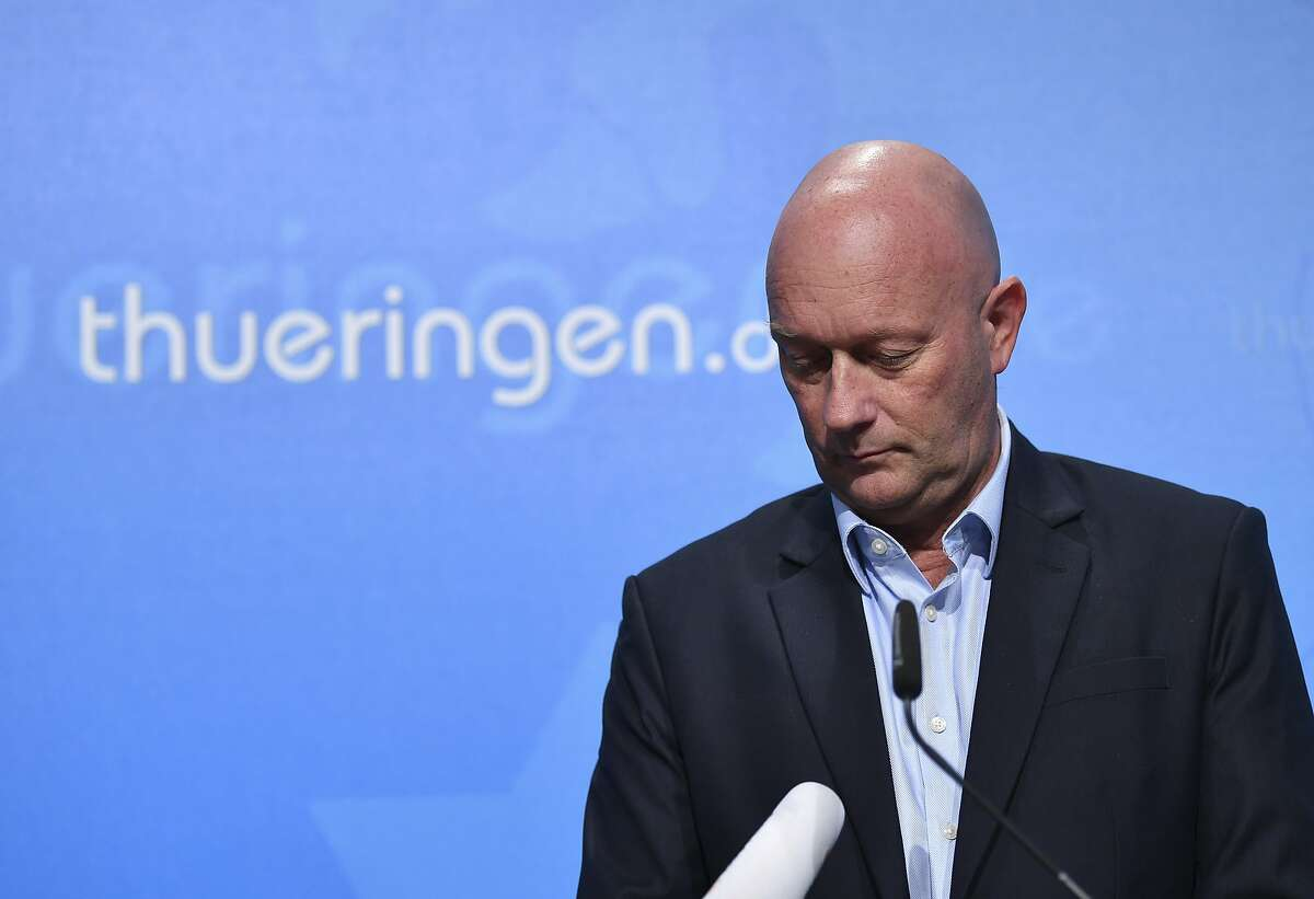 Thuringian state governor Thomas Kemmerich of the Free Democrats party briefs the media during a news conference in Erfurt, Germany, Thursday, Feb. 6, 2019. (Martin Schutt/dpa via AP)