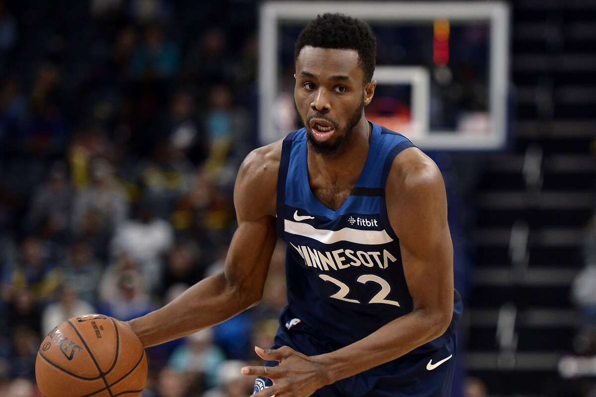 Minnesota Timberwolves forward Andrew Wiggins (22) handles the ball in the first half of an NBA basketball game against the Memphis Grizzlies Tuesday, Jan. 7, 2020, in Memphis, Tenn. (AP Photo/Brandon Dill)