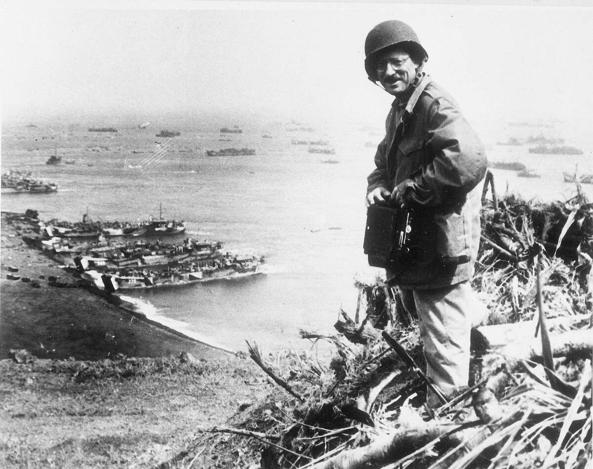 ** FILE **Joe Rosenthal, Associated Press photographer, is shown with his camera equipment looking over Iwo Jima, Japanese volcano island, in March 1945 during World War II. (AP Photo/U.S. Marine Corps/FILE)
