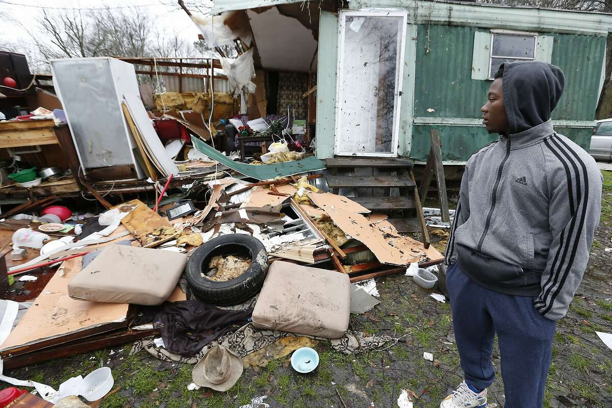 """""""It sounded like it was coming for us,"""" says DeMarkus Sly, 19, as he surveys the remains of his grandmother's home in Pickens, Miss., following Wednesday's series of storms that hit Mississippi, Thursday, Feb. 6, 2020. The home was occupied by five family members including Sly, but none were seriously injured when the home was destroyed by the winds. (AP Photo/Rogelio V. Solis)"""