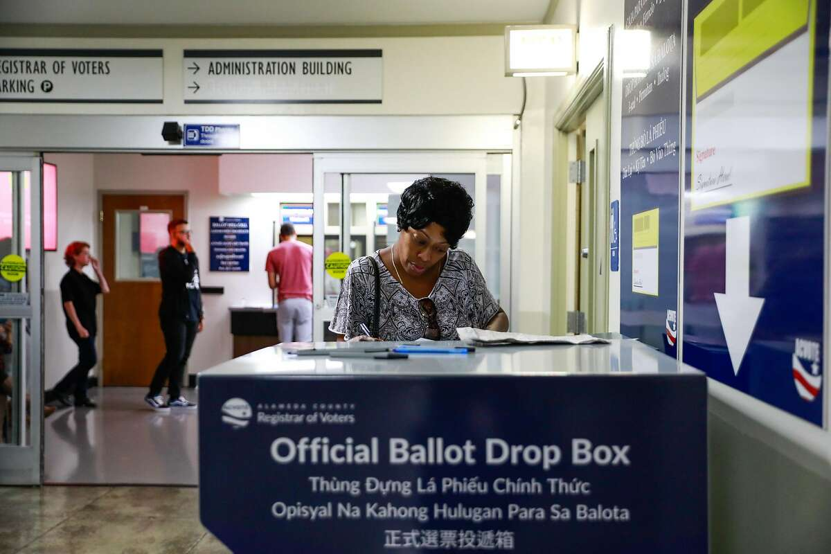 Gwen Monroe fills out a ballot as she casts her vote at the Registrar of Voters office in Oakland, California, on Monday, Nov. 5, 2018.