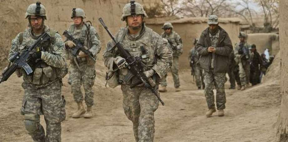 U.S. Army soldiers with the 4th Battalion, 23rd Infantry Regiment, 5th Brigade Combat Team, 2nd Infantry Division and Afghan National Army soldiers conduct a combined patrol in the village of Shabila Kalan, Zabul, Afghanistan, on Nov. 30, 2009.
