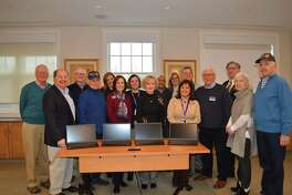 Area Rotarians with members of the RVNAhealth leadership team and the newly purchased laptops: Joe Cleary; Ralph Passarelli; Joel Third; Mike Anderson; Keri Linardi, RVNAhealth; M.J. Heller, RVNAhealth; Gigi Weiss, RVNAhealth; Geri Blair; Mario Boursiquot, RVNAhealth; Melissa Papish, RVNAhealth; Theresa Santoro, RVNAhealth President & CEO; John Apinis, RVNAhealth; Christopher Hoeffel, Rotary District 7980; Robert Herber; Sue Manning; Bill Wyman.