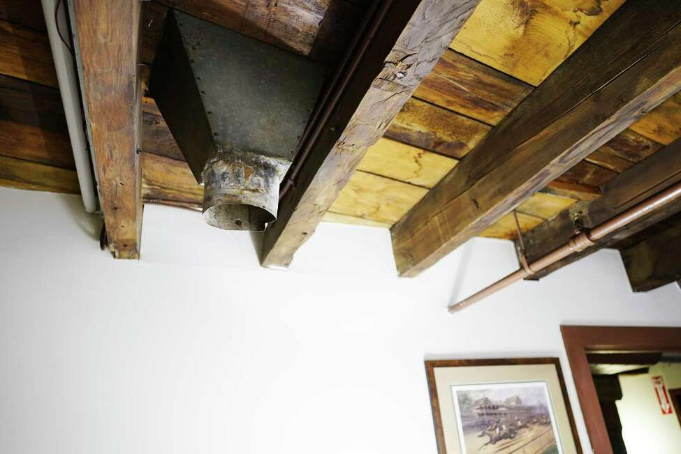 A view of a section of a hopper coming through the ceiling on the fourth floor inside the building housing the offices of the Preservation League of New York State, located at 44 Central Ave. on Monday, Feb. 3, 2020, in Albany, N.Y. The hopper is left from a time when the building was used to process grains. (Paul Buckowski/Times Union)