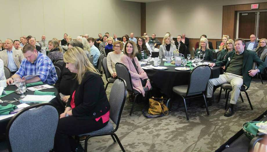 Area residents, business owners and community stakeholders filled the University Center ballroom on Ferris State University's campus Thursday morning for the annual Mecosta County Area Chamber of Commerce meeting. (Pioneer photo/Taylor Fussman)