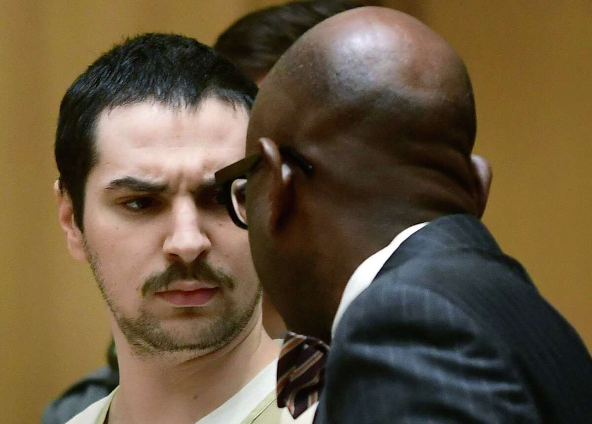 Brandon Wagshol appears with his attorney Darnell Crosland for an arraignment on charges of assaulting his father Thursday, February 6, 2020, at Stamford Superior Court in Stamford, Conn. The assault occurred when Wagshol was under house arrest as his case progresses on charges of possession of illegal high-capacity gun magazines.