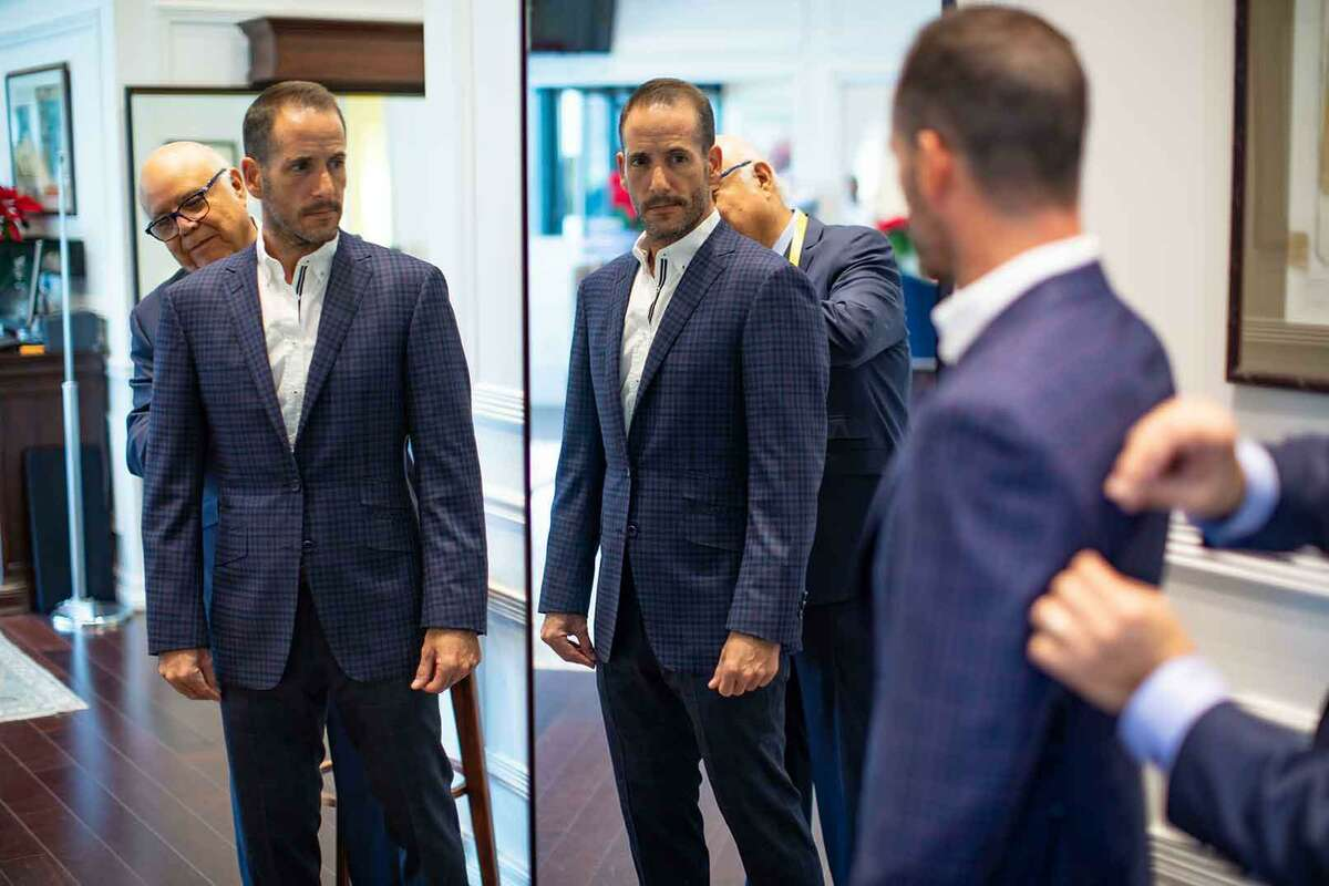 Nick Lopez works on a customer's suit. Nick Lopez Tailoring has relocated in the Houston Galleria area to 2121 Sage Road.