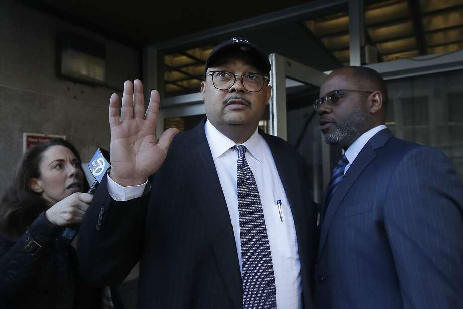 Mohammed Nuru, director of San Francisco Public Works, center, gestures as he leaves a federal courthouse with attorney Ismail Ramsey, right, in San Francisco, Thursday, Feb. 6, 2020. The FBI arrested public works director Mohammed Nuru and restaurateur Nick Bovis last week, saying the men schemed in 2018 to bribe a San Francisco airport commissioner for prime restaurant space at San Francisco International Airport. (AP Photo/Jeff Chiu) Photo: Jeff Chiu, Associated Press