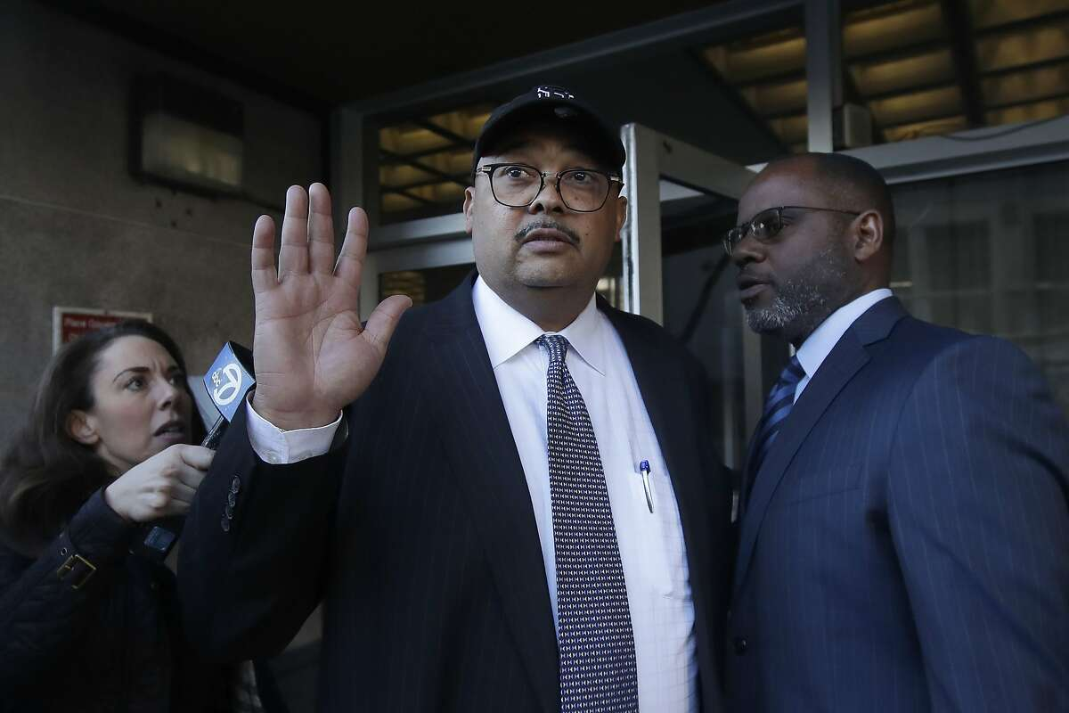 Mohammed Nuru, director of San Francisco Public Works, center, gestures as he leaves a federal courthouse with attorney Ismail Ramsey, right, in San Francisco, Thursday, Feb. 6, 2020.