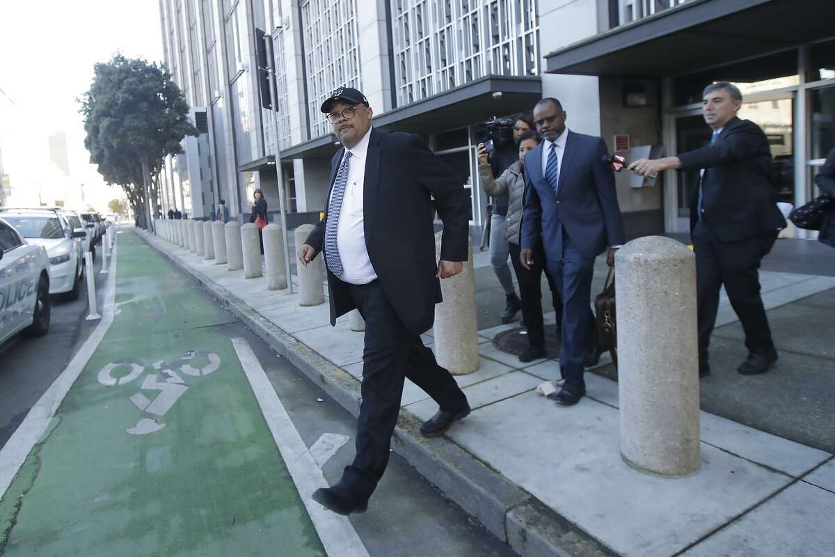Mohammed Nuru, director of San Francisco Public Works, left, walks in front of attorney Ismail Ramsey as they leave a federal courthouse in San Francisco, Thursday, Feb. 6, 2020. The FBI arrested public works director Mohammed Nuru and restaurateur Nick Bovis last week, saying the men schemed in 2018 to bribe a San Francisco airport commissioner for prime restaurant space at San Francisco International Airport.(AP Photo/Jeff Chiu)