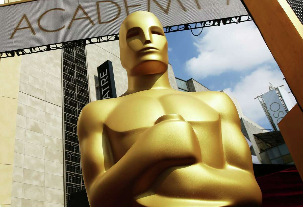 FILE - An Oscar statue appears outside the Dolby Theatre for the 87th Academy Awards in Los Angeles. (Photo by Matt Sayles/Invision/AP, File)