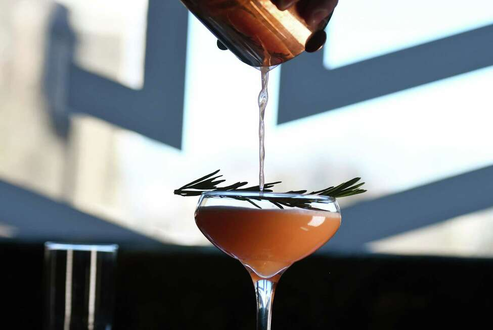 Bourbon rosemary punch cocktail from The Bishop; Woodford Reserve bourbon, honey & rosemary syrup, grapefruit juice, Aperol and a a rosemary sprig garnish on Tuesday, Jan. 21, 2020, on North Pearl Street in Albany, N.Y. (Will Waldron/Times Union)
