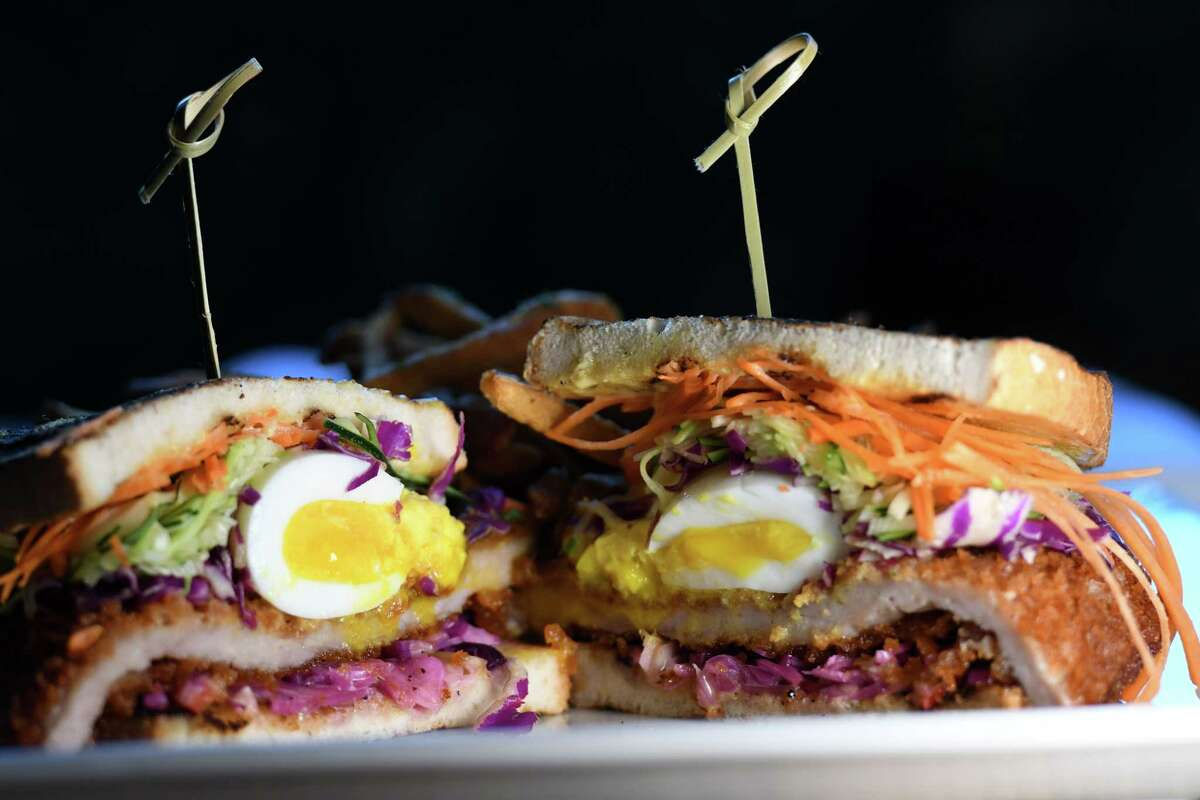 Pork katsu from The Bishop; fried pork filet, raw veggies, slaw, herbs, rice wine vinegar, soy aioli and egg on Tuesday, Jan. 21, 2020, on North Pearl Street in Albany, N.Y. (Will Waldron/Times Union)