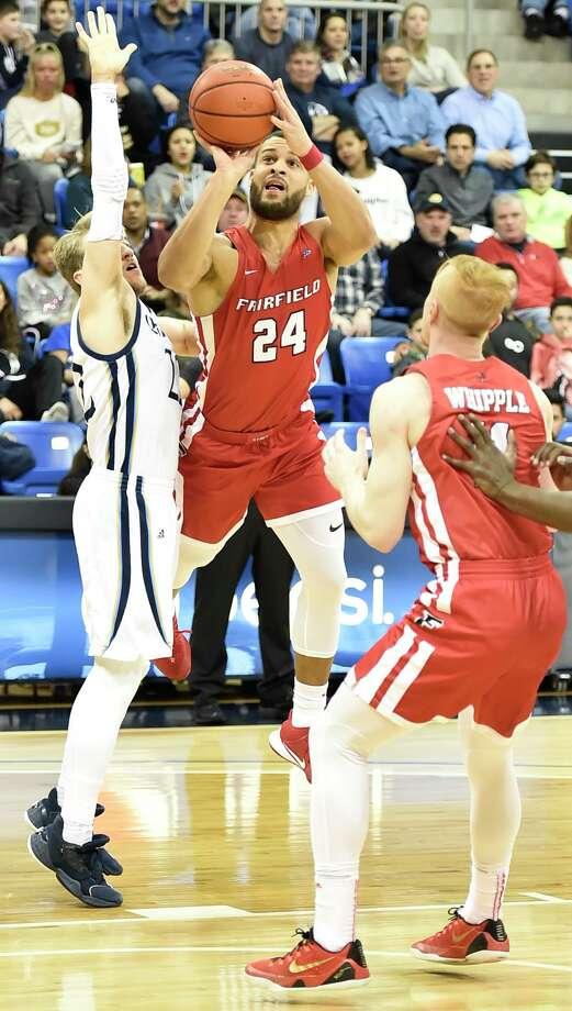 Fairfield's Jesus Cruz shoots and scores against Quinnipiac in Hamden earlier this season. Photo: Peter Hvizdak / Hearst Connecticut Media / New Haven Register