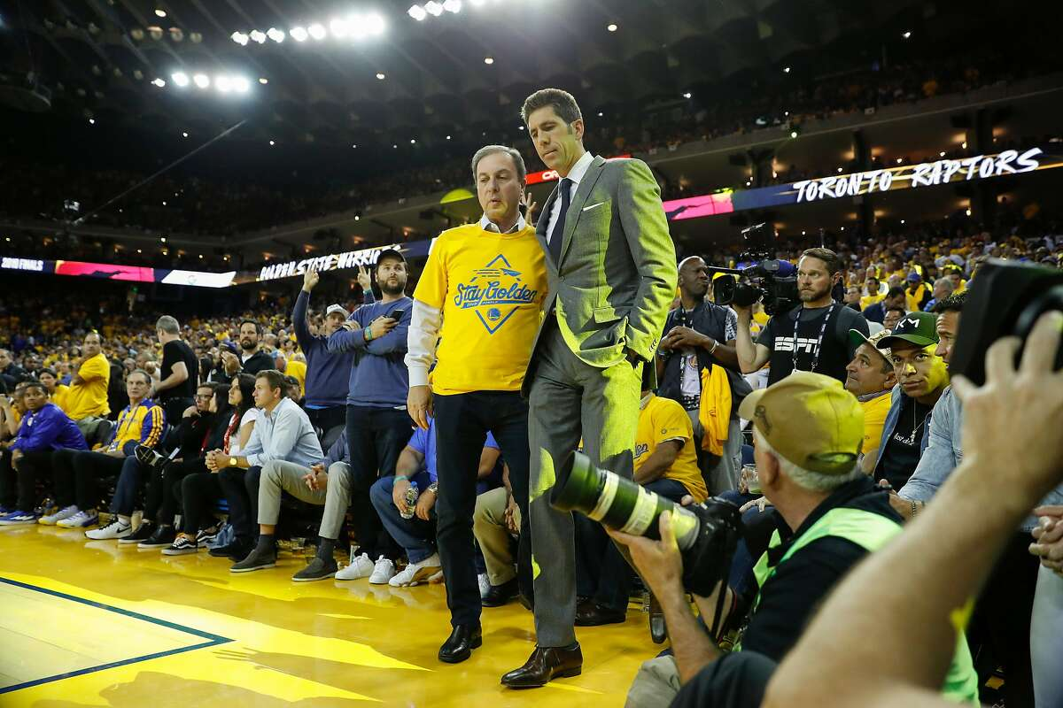 Golden State Warriors� Joe Lacob and Bob Myers talk in the fourth quarter during game 6 of the NBA Finals between the Golden State Warriors and the Toronto Raptors at Oracle Arena on Thursday, June 13, 2019 in Oakland, Calif.